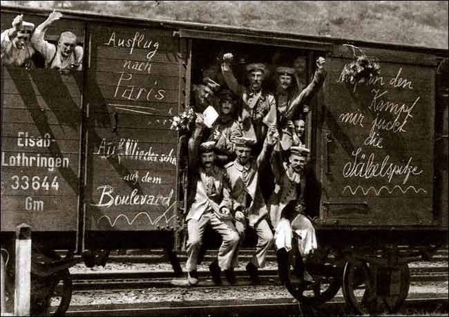 German_soldiers_in_a_railroad_car_on_the_way_to_the_front_during_early_World_War_I,_taken_in_1914._Taken_from_greatwar.nl_site
